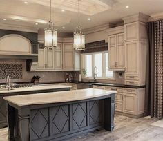 Kitchen Remodel Ideas Dark grey island with white countertop and antique white cabinets with black countertop by robert Antique Kitchen Cabinets, Kitchen Cabinet Design, Painting Kitchen Cabinets, Dark Cabinets, Grey Cupboards, Cherry Cabinets, Kitchen Cabinetry, Wood Cabinets, Cuisines Diy