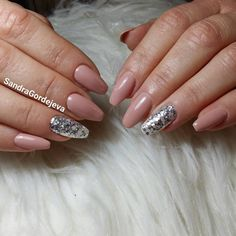 nude gel nails with silver flakes
