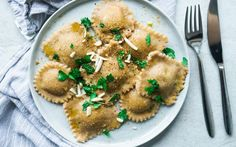 These ravioli are the perfect winter comfort food. The flavor of the Hokkaido pumpkin and spinach filling is just strong enough to go perfectly with the hearty whole wheat pasta dough and subtle enough to not be overpowering.