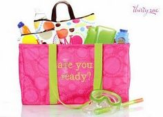 Thirty-One Gifts Large Utility Tote.   Super cute and holds 4-5 beach towels plus toys!  Can't beat it!