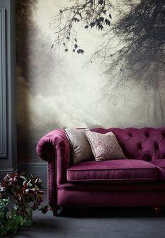 Love the velvet sofa against the atmospheric landscape wallpaper!