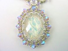 DIY Jewelry: FREE beading pattern for an 18x25mm cabochon netted bezel with Victorian lacy chain, made with 11/0 and 15/0 seed beads, and 4mm crystals.