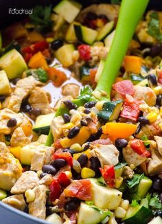 Low carb chicken and zucchini recipe cooked in one skillet with black beans, corn, fresh herbs, taco seasoning and melted cheese on top.