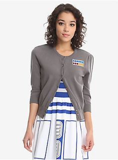 """Take command of your wardrobe with this subtle Imperial High Commander cardigan. <i>Star Wars</i> fans will recognize this reference immediately, while others will just admire the look of this classic grey cardigan. It has 3/4 length sleeves and provides stretch. Runs true to size according to juniors sizing, however if you have a larger chest, we recommend going one size up.<div><ul><li style=""""list-style-position: inside !important; list-style-type: disc !important"""">Officially license..."""