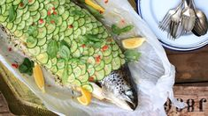 Whole baked salmon stuffed with lemon and herb rice