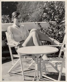 Audrey Hepburn. Tanning. And showing legs.