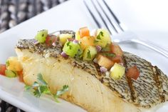 Grilled sea bass in spicy lemon marinade. Herbs, garlic and olive oil contribute richness and big flavor to this fish recipe.