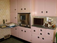 A wonderful vintage pink kitchen... with pink steel cabinets...