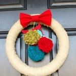 I made this wreath for Valentine's Day with red, white, and pink pom poms of course.