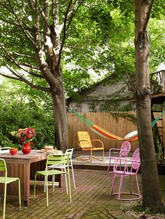 Pops of Color~~Add a splash of color to an outdoor seating area with bright chairs. In this space, green, pink, and orange metal chairs pop against the neutral deck.