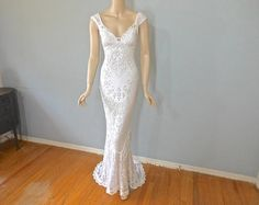 One of a kind, white lace bohemian wedding dress, made from vintage laces. Stunning off the shoulder bodice, with a plunging neckline framed with