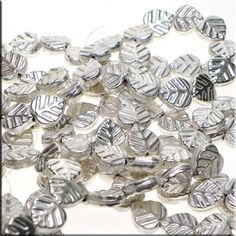Wholesale Leaf Beads, Sterling Silver Plated, Bulk Strand (29) - Wholesale Sterling Silver Plated Copper Leaf Beads. These Leaf Beads measure approximately 15mm long x 14mm wide and 5.5mm deep and have ~1.75mm holes. As these were hand-crafted, slight variations may occur. Sold by wholesale bulk strand of 29-pieces, these metal Leaf Beads are also available Individually (please see listing F2209).