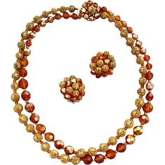 Vintage 1960s Marvella necklace and earrings with amber cut crystals and lacy goldtone metal beads.  Double strand necklace is 18 inches end to end.