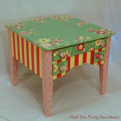 This beautiful solid wood end table is hand painted in the colors of light sage, bubble gum, watermelon, and a whisp of lemon. The detail needs to be seen in person to be appreciated. No stencils are used, everything is painted freehand. It could be used in a more mature setting, or for a child.