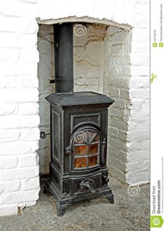 old victorian wood stoves | Photo of a old black iron victorian wood burning stove in situ.