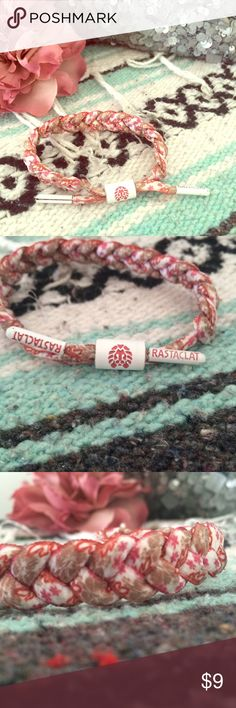 Floral Rastaclat White rastaclat with pink red and tan floral design. White aglets and middle charm with pink details. Worn a few times. In overall good condition.  No trades  No ️ay️al  No Ⓜ️ercari ask me about bundles  lowest prices up front  Rastaclat Jewelry Bracelets