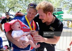 British double gold winner (recumbant cycling) Rob Cromey-Hawke and his daughter Pippa meet Prince Harry at the road cycling event during the Invictus Games Orlando 2016 at ESPN Wide World of Sports on May 9, 2016 in Orlando, Florida. Prince Harry, patron of the Invictus Games Foundation is in Orlando ahead of the opening of Invictus Games which will open on Sunday. The Invictus Games is the only International sporting event for wounded, injured and sick servicemen and women. Started in…