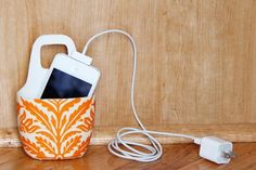 Unless all your outlets are perfectly located near desks and countertops, you probably have to deal with the annoying mess of cords and gadgets — not to mention the worry of them getting stepped on, or chewed up by pets. This clever little DIY is not only a great way to hold your phone while it's charging, but also reuse a common household item.