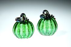 Rich Green Glass Pumpkin, This piece is one of our smaller pumpkins, they range in size from 3-4 inches. Some of the pumpkins we roll through a little frit on the surface, frit is small chips of glass that give the piece a little extra sparkle. This is a great fall wedding gift, Fall decor, gift for mom, gift for a friend, gift for dad, fall wedding gift, or anniversary gift. #falldecoration #glasspumpkin #artglass #blownglass #halloweendecor #giftformom #thanksgivingdecoration Small Pumpkins, Glass Pumpkins, Thanksgiving Decorations, Halloween Decorations, Corning Museum Of Glass, Blown Glass Art, Fall Gifts, Gifts For Dad, Decorative Bells