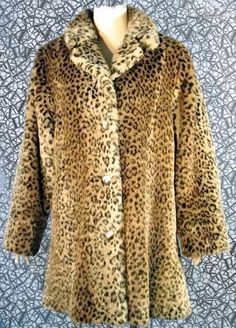 Vintage 70's Fabulous CHEETAH Print FAUX FUR Coat ~ Stroller Length, MED At THE HULA HUT AND MORE STORE.    http://www.ebay.com/itm/Vintage-70s-Fabulous-CHEETAH-Print-FAUX-FUR-Coat-Stroller-Length-MED-/221121495482?pt=Vintage_Women_s_Clothing=item337bde41ba