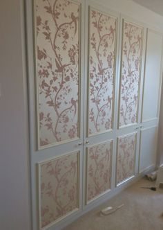 Laura Ashley wallpaper Oriental Garden in Chalk Pink put on the fitted wardrobe doors opposite the matching feature wall in our bedroom :)