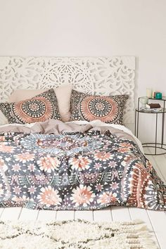A relaxed bedroom setting with vibrant boho style bedding.