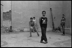 """""""Cairo Boys"""" by Veasey J. Conway '12 in the City of the Dead, Cairo, Egypt.    Cairo is unique in that some of its eighteen million citizens literally live among the dead. Large above-ground cemeteries - collectively known as the City of the Dead - have become squatter homes for the city's exploding population. These boys, found near Coptic Christian cemeteries, stopped their soccer game long enough to pose for a picture."""