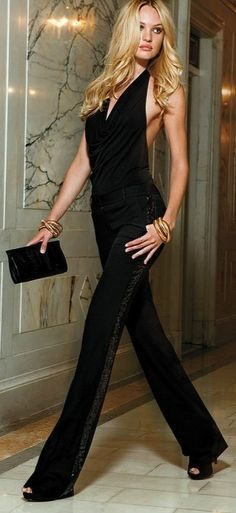 Black on black: dress pants, halter top, bangles and clutch. Street style