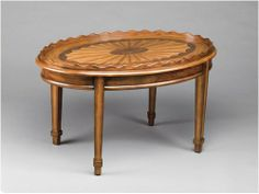 AA Importing Oval Coffee Table in Medium Brown 46934 by AA Importing. $214.78. Raised scalloped edge. Oval shape. Dark and medium brown finish design on top. 38 in. L x 27 in. W x 22 in. H (48.4 lbs.). 46934 Features: -Oval coffee table.-Raised scalloped edge. Color/Finish: -Medium brown finish. Assembly Instructions: -Assembly required.. Save 44%!