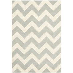 This geometric wool rug adds a contemporary touch to any room in your house. Handmade from pure wool, this floor covering is guaranteed to pamper your feet with warmth and comfort. The chevron stripes of grey and ivory highlight this beautiful rug.