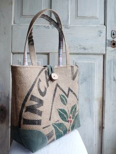 New upcycled LeAH tote bag! Coffee burlap sack exterior, lined with upcycled plaid collared shirt (along with the pockets) and corners protected with upcycled green corduroy trousers :) Check it out!! http://www.etsy.com/listing/98936284/upcycled-tote-everyday-bag-book-bag