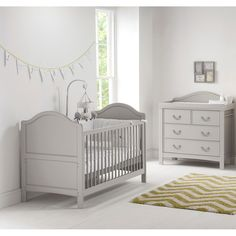 This beautiful vintage style 2pc Cot Bed and dresser in French Grey finish by East Coast Nursery, features 2 protective teething rails (offer protection to both your little one's teeth and the side rails), 3 base heights, 2 fixed sides and converts to a Day Bed and also a Toddler Bed with an additional end, for when your child is a little older.The Toulouse 3 Drawer Dresser is the perfect finishing touch for your Baby's Nursery. Beautiful and elegant vintage style, the Toulouse Dresser…