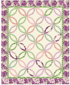"""The Double Wedding Ring is the most popular pattern in the history of quilting. The 1928 pattern explains the origin of the design: """"When so..."""