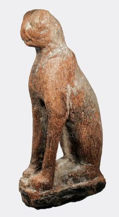 An elegant carved hardwood figure of a seated cat, sacred to the goddess Bastet.  The cat is depicted seated squarely on a shallow plinth with his tail wrapped around the right side of his haunch. The head is delicately carved and retains incised decoration around the eyes and muzzle.  Egypt, Late Dynastic Period, 730-332 BC  Intact as shown  Size: 9.4 x 4.6 cms  Ex. private collection, Sweden; acquired 1970's.