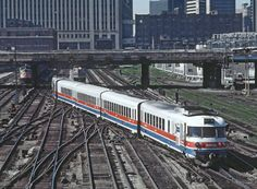 """Caption: """"Amtrak Turboliner 67 'backing' in to Chicago Union Station on July 3, 1977. This guy left the south end of the coach yard, reversed at about 18th Street, and was 'backing' into Union Station.""""  Photo by Marty Bernard"""