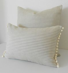 One pillow cover made to fit a size 12x18 pillow.  Small scale tan and cream striped fabric aligned on both the front and back sides. Finished