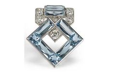 Art Deco Cartier platinum (or white gold) aquamarine and diamond clip brooches from c.1930