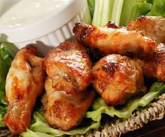 Oven baked sweet hot chicken wings.Chicken wings with honey,Dijon mustard,soy sauce and salsa. Delicious!!!