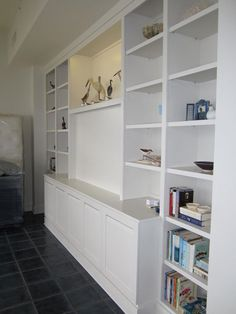 Built-in entertainment center with AP101 aluminum pull handle cabinet doors and bookshelves painted white