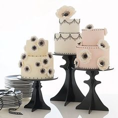 Yes! Tall cake stands with gorgeous anemone flower wedding cakes.