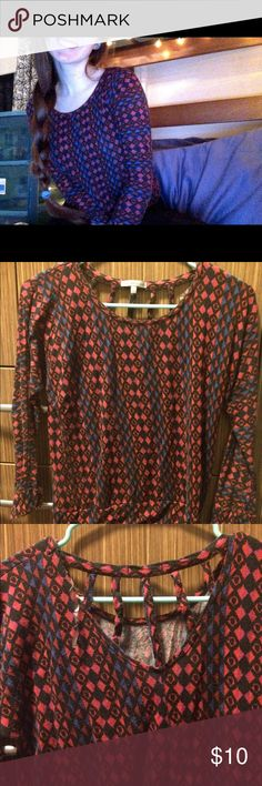 Charlotte Russe top Blue and red printed long sleeve top (triangles/geometric pattern), pretty soft/comfy! Has a sorta cool back design if you're into that. The first pic is closer to its actual color, the lighting in my current apartment (2nd and 3rd pics) is just terrible Charlotte Russe Tops Tees - Long Sleeve