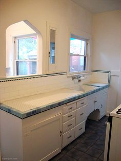 darling kitchen with original honeycomb tile countertops | kitschy