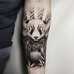 bw panda tattoo idea on the forearm