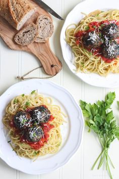 This recipe takes spaghetti and meatballs up a notch! Delicious Florentine Meatballs made with spinach and parmesan cheese are roasted in the oven then finished in a tasty marinara sauce. | LoveGrowsWild.com