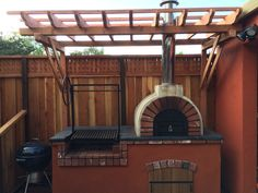 A great combination of an Argentine Grill and a Wood-Fired Outdoor Pizza Oven in California.  BrickWoodOvens.com