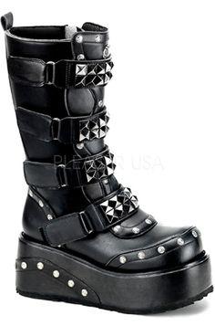 "Demonia Truck 200 Boot        Black        Knee high boot        Pyramid studded velcro straps        Stud detail        Inside zipper        3 1/2"" platform        Man-made"