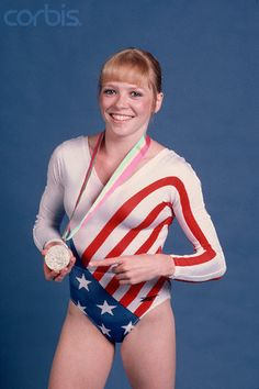 Gymnast Julianne McNamara holds the silver medal she won in the floor exercise competition. She also won a gold medal for her performance on the uneven bars at the 1984 Olympic games in Los Angeles. Photo © Neal Preston/CORBIS