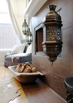 Moroccan lanterns hanging off the modern mantle...brilliant juxtaposition! by georgette