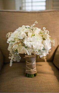 Beautifully understated and rustic...yes please!! @Samantha Hook love the white with the burlap wrapped around the stems!