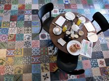 Cement tile floor in patchwork design.